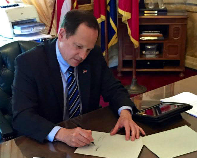 Mayor Francis Slay signs the bill authorizing a vote on new capital-improvement bonds.