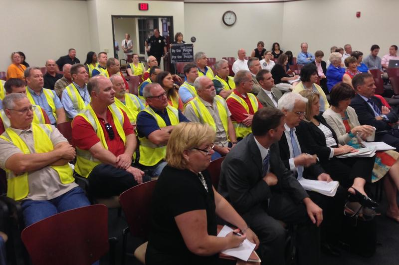 The coal ash landfill hearing got underway at 9 a.m. and lasted into the evening. Ameren employees wearing bright yellow vests attended the hearing in shifts throughout the day.
