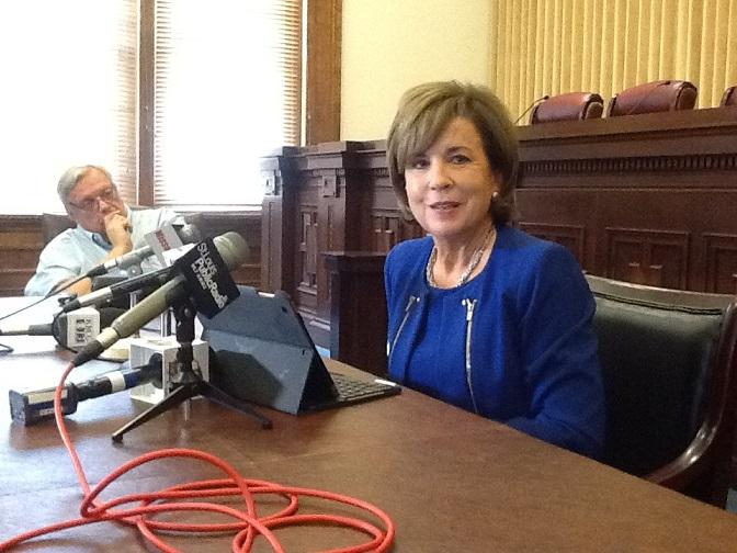 Mary Russell discusses her tenure as chief justice with reporters Tuesday.