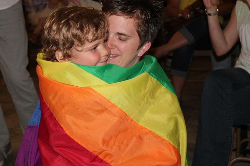 This young man wore the rainbow flag proudly and lovingly.