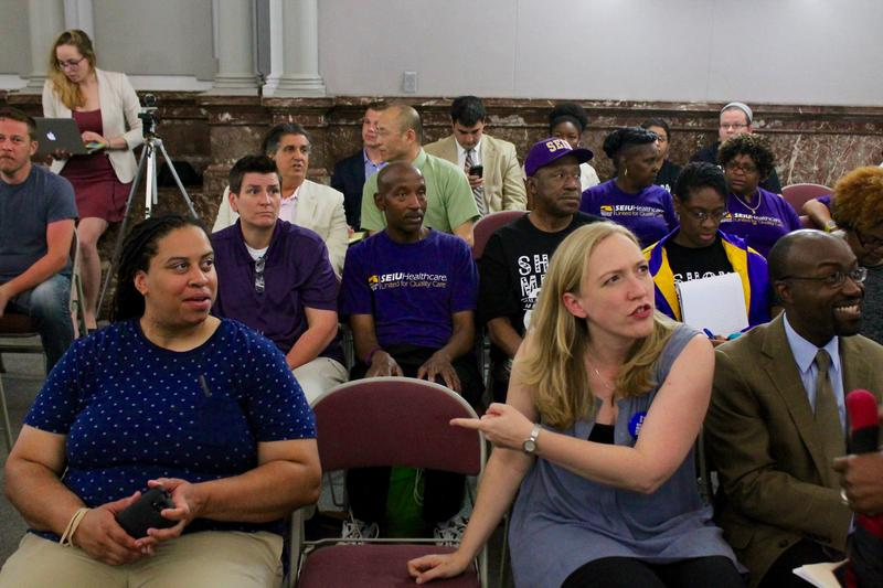Supporters of a city minimum wage hike sit through a hearing of the St. Louis Board of Aldermen Ways and Means Committee.