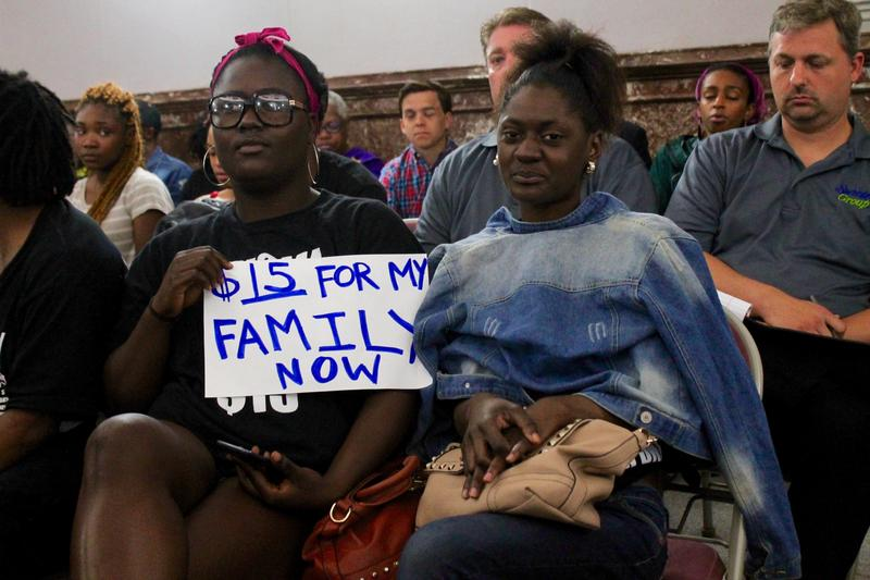 Supporters of raising St. Louis' minimum wage listen to testimony Tuesday at St. Louis City Hall.
