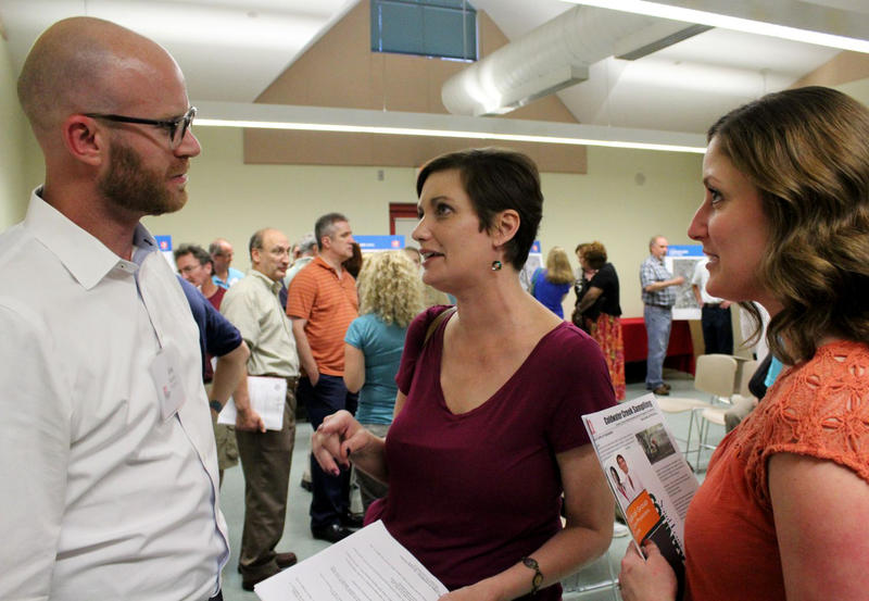 Michelle Seeger questions Army Corps health physicist Jonathan Rankins while her sister Julie Pinkston looks on. Seeger grew up near Coldwater Creek and has Stage IV cancer.