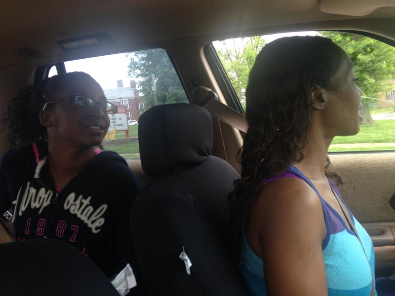 Johnnina Ray drives her daughter, 14-year-old Jakayla, home from school.