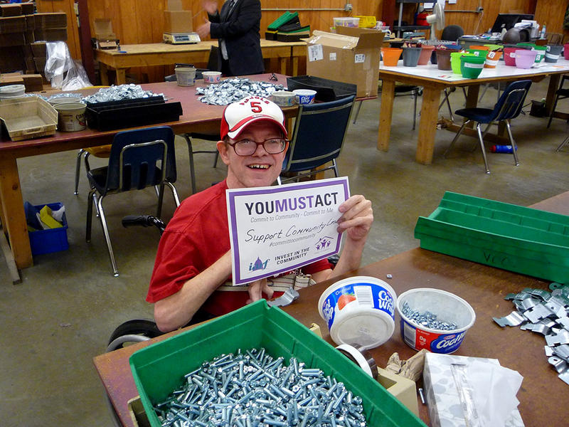 Worker at one of Community Link's workshops for adults with developmental disabilities.