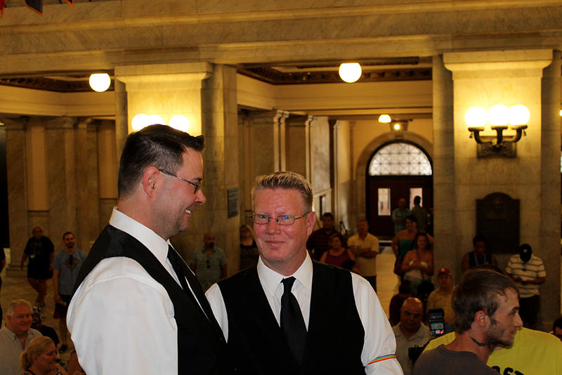 Dale Crawford, left looks at his soon-to-be husband as their wedding ceremony begins Saturday, June 27, 2015. The couple lives in south St. Louis County and grew up in the St. Louis area.