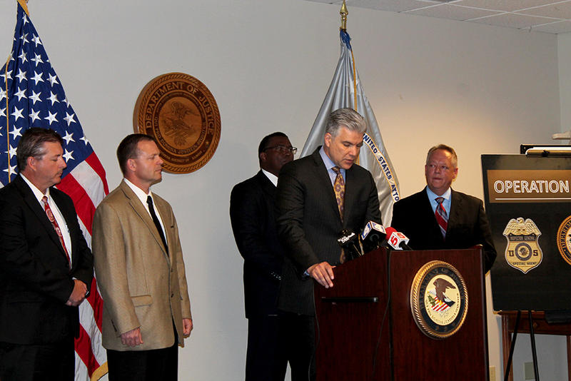Gerald Roy with the U.S. Department of Health and Human Services speaks at a news conferenc announcing fraud charges while Stephen Wiggington, U.S. Attorney for the Southern District of Illinois looks on to the right on Thursday, June 18, 2015.