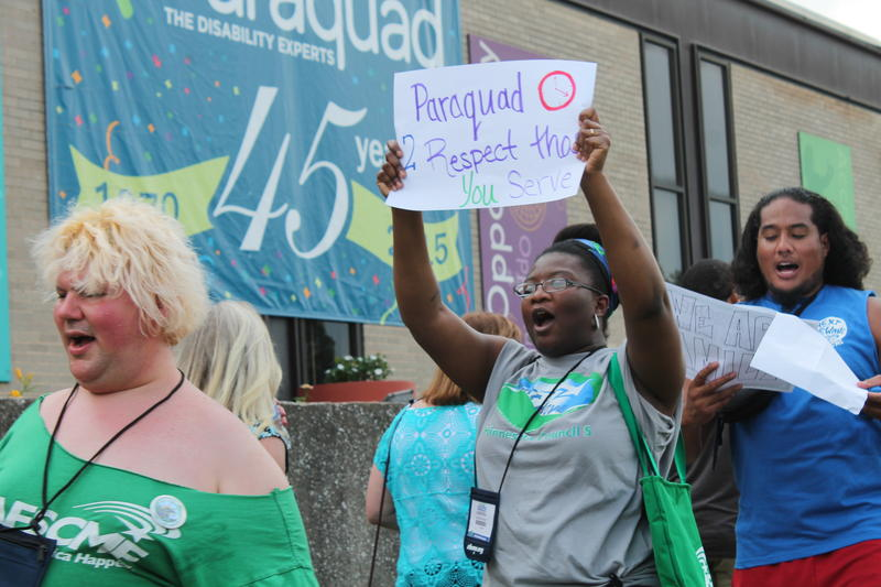 AFSCME members and supporters demonstrate outside of Paraquad, calling for higher wages for home health workers. The Missouri Home Care Union is affiliated with AFSCME.