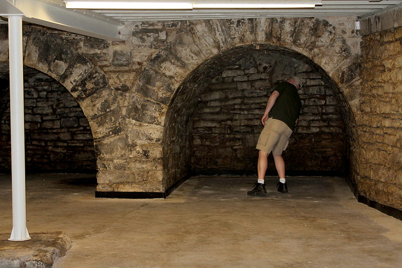 Joel Joblanski checks out the arch in the basement of the William Kerr Foundation building, originally the home of the Belcher Bath House, circa 1894.