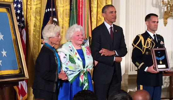 Ina Bass and Elsie Shemin-Roth, the daughters of World War I Sgt. William Shemin, accept the Medal of Honor from President Barack Obama.