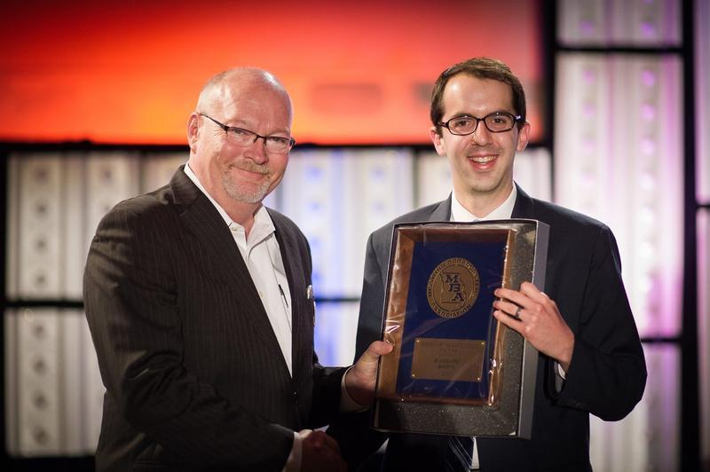 Reporter Jason Rosenbaum receives an award