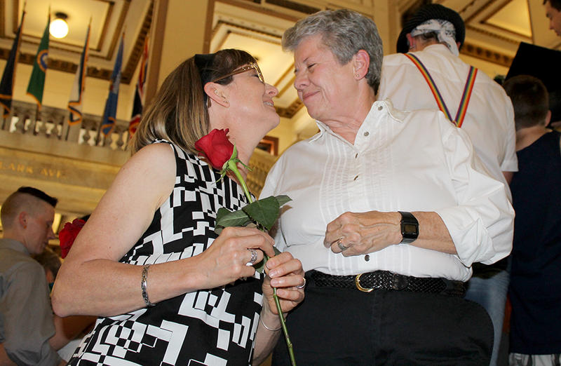 Monica Rea, left, and Pam Grakanoff lean back from a kiss after exchanging rings Saturday, June 27, 2015 at St. Louis City Hall.