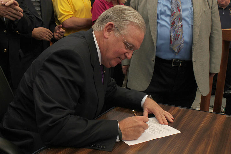 Gov. Jay Nixon ceremonially signs his veto of right to work Thursday, June 4, 2015 in St. Louis.