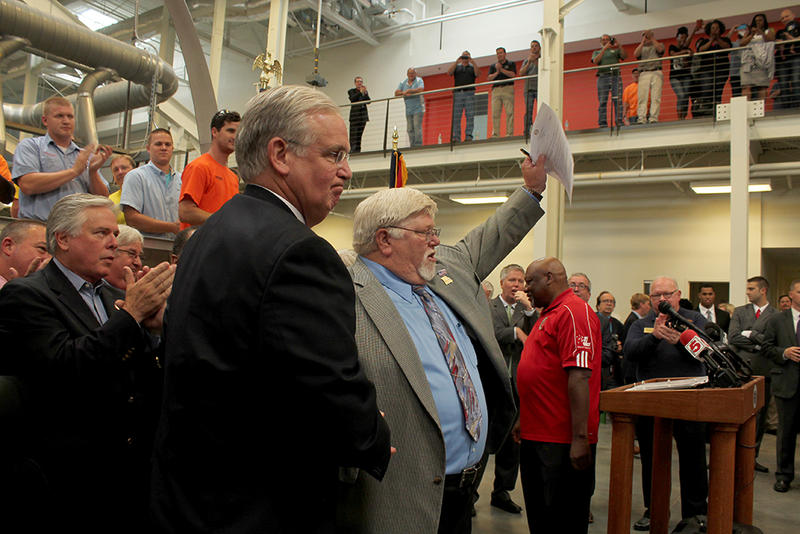 "Local 36 sheet metal worker leader Ernie Angelbeck celebrates Gov. Jay Nixon's signature vetoing ""right to work"" at a news conference Thursday, June 4, 2015 in St. Louis."