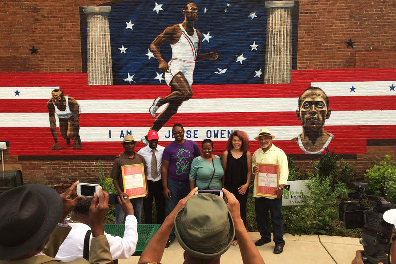 Artists and students gather before new Old North mural of Jesse Owens