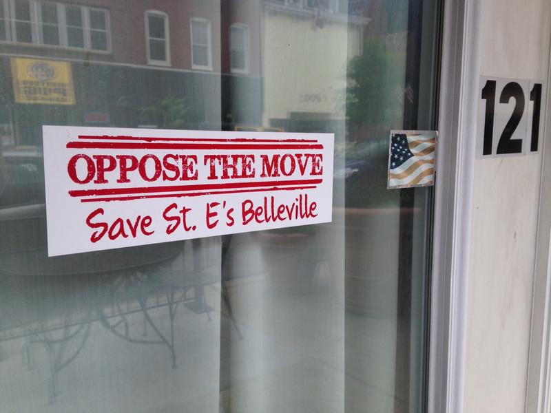 A sticker opposes St. Elizabeth's relocation on a door in downtown Belleville, on 06/04/15.