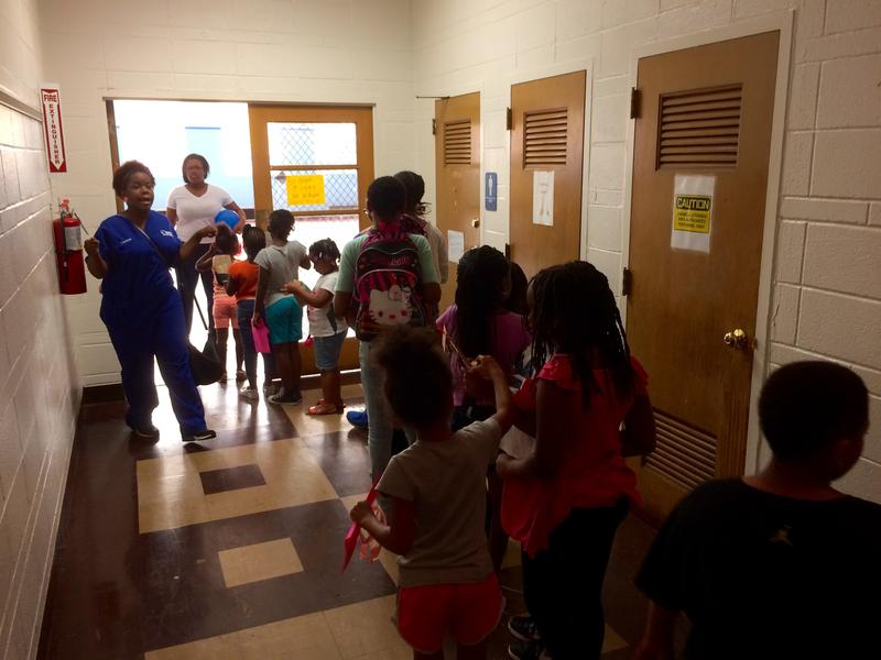 Children at the JSO Summer Learning Enrichment Program line up to play dodgeball last Tuesday. The camp takes place at Greater St. Mark Family Church's school, which had its air conditioning units stolen earlier this year.