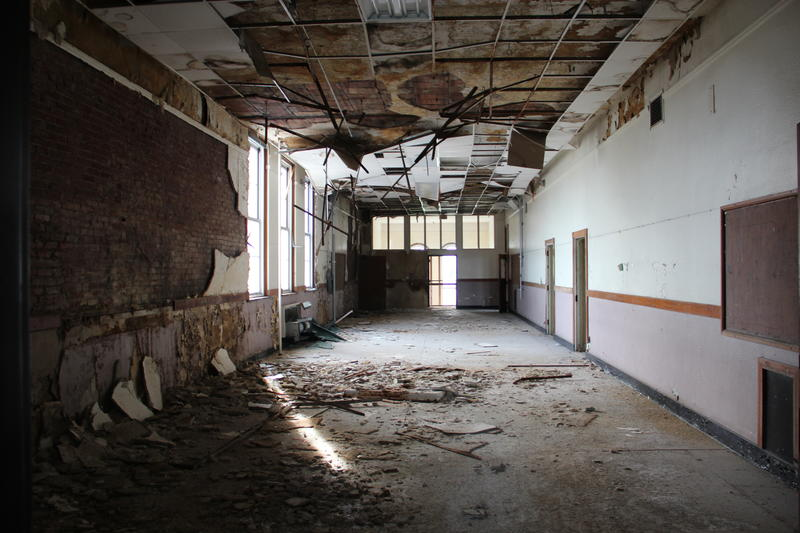 A classroom inside of Eliiot Elementary. The sub-ceiling is down, paint is stripped off the walls, all the copper is out of the building and the alarm system's been ripped out.