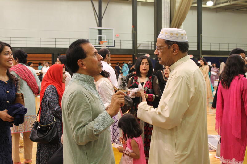 People greet and congratulate each other on completing the Ramadan fast after the Islamic Foundation of Greater St. Louis' Eid prayer service in the gym of St. Louis Community College-Forest Park.