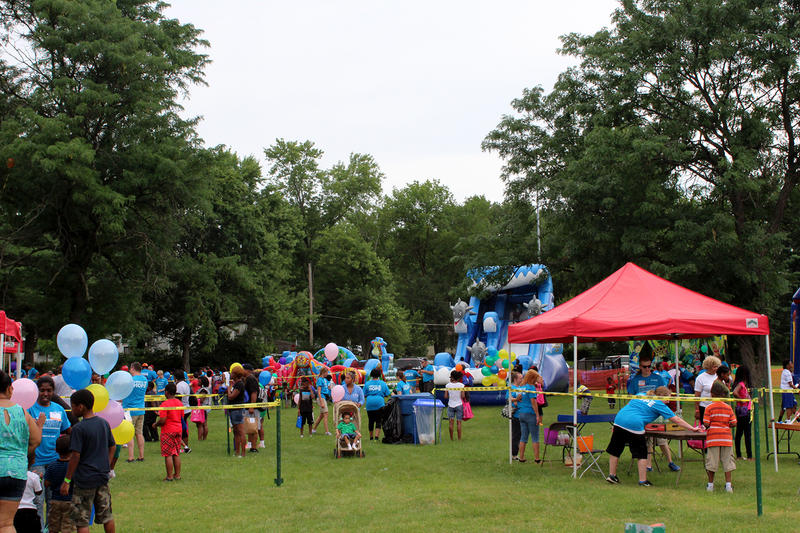 Organizers said one goal of the event at Forestwood Park was for families to have a fun, stress-free day. Bounce houses and other activities helped make that happen at the kid's carnival area Saturday July 25, 2015.