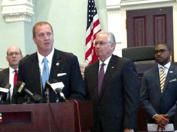 The main sponsor of SB5, state Sen. Eric Schmitt, R-Glendale, talks about the bill as Gov. Jay Nixon, right, looks on.