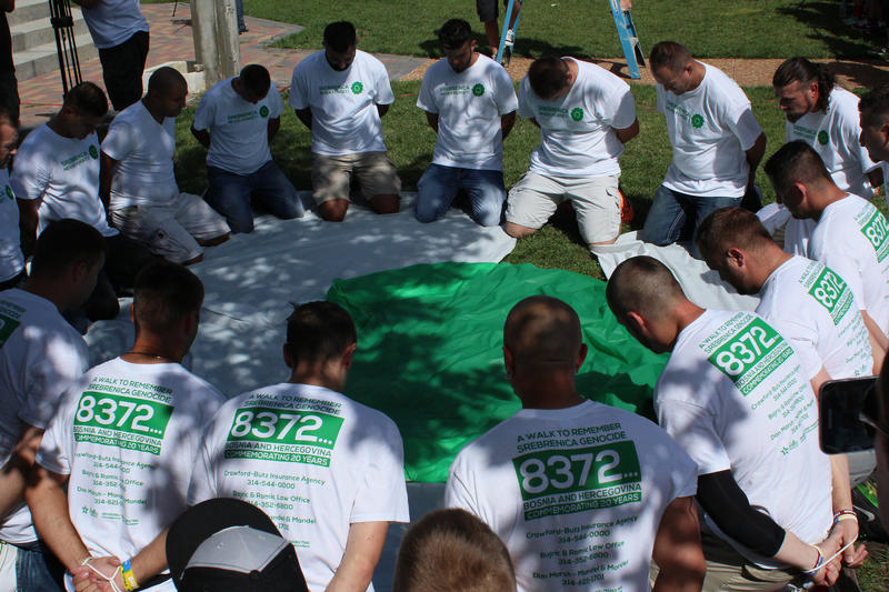 Srebenica Flower participants first reenact the position in which some Bosnians were killed during the war