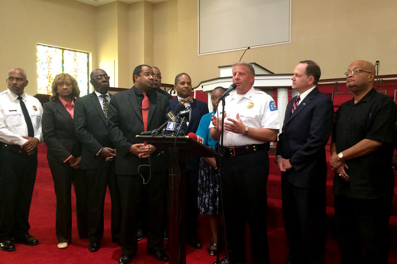 St. Louis police chief Dotson speaks beside clergy and Mayor Francis Slay Thursday in Fountain Park, calling for calm after a night of unrest.