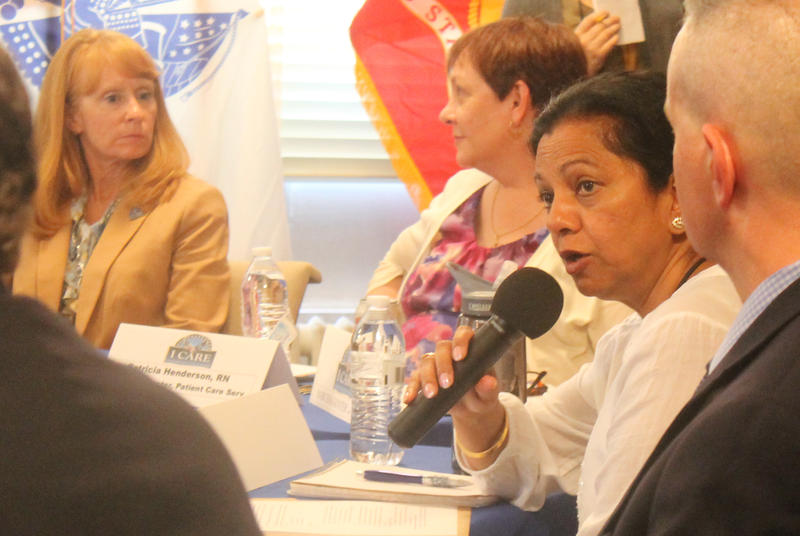 Dr. Anupam Agarwal, (with microphone), responds to a patient advocate during a roundtable discussion in St. Louis. She serves as acting chief of staff for the St. Louis VA health system.