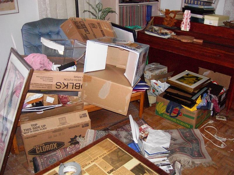 Soggy boxes and other items in Fred Onovwerosuoke's house following Hurricane Katrina
