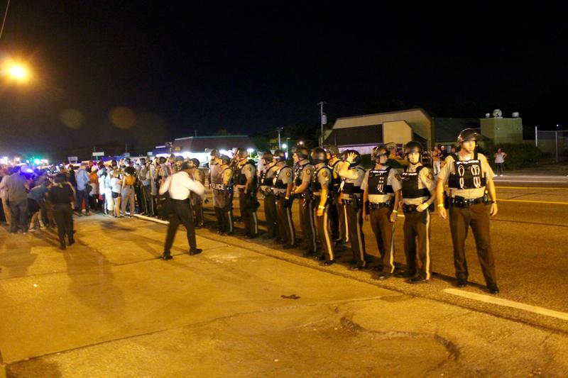 St. Louis County Police form a line in front of protesters on Tuesday. They were put in charge of securing protests on Monday when St. Louis County Executive Steve Stenger called a state of emergency.