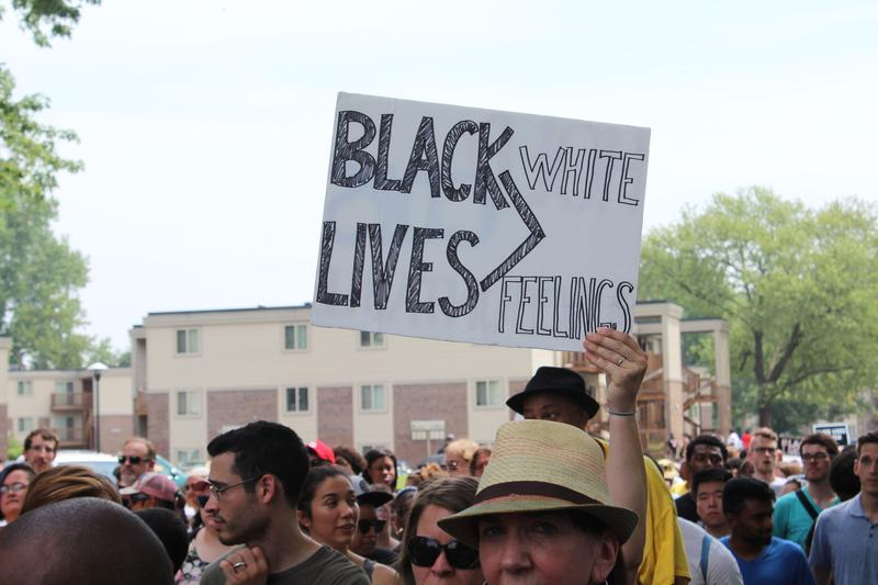 A demonstrator holds up a sign during a march to Greater St. Mark Church in Ferguson.