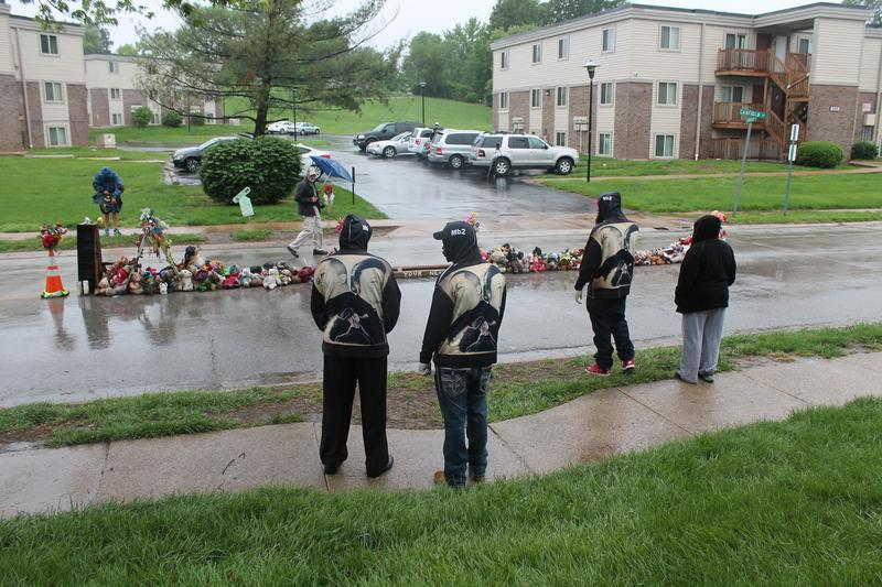Michael Brown, Sr., (second from the right) stands in front of the temporary memorial dedicated to his son Michael Brown, Jr. earlier this year. Brown's death had a monumental impact on the city of Ferguson -- and the St. Louis region.