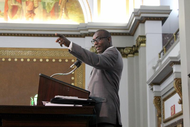 Aldermen President Lewis Reed during debate