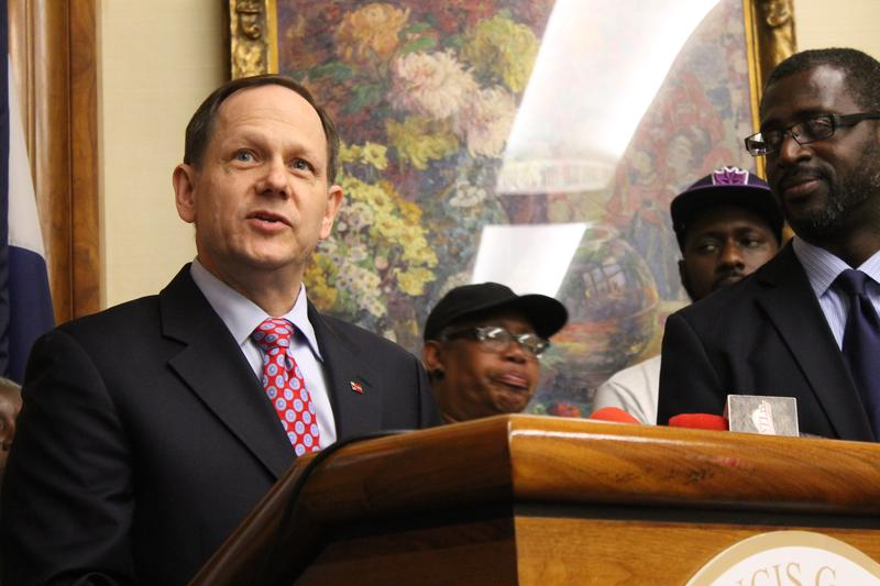 St. Louis Mayor Francis Slay speaks to the media before signing a minimum wage increase into law on Friday.