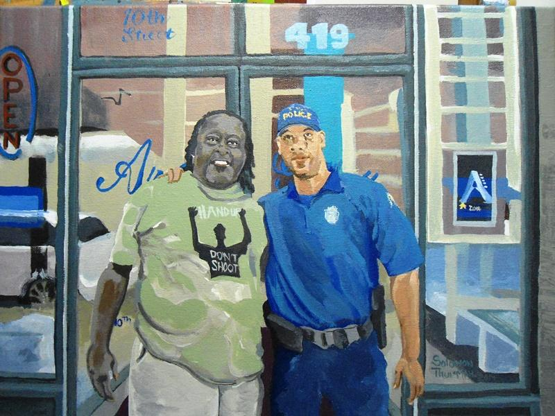 "This painting of an officer and an artist wearing a ""Hands Up, Don't Shoot"" shirt, by Solomon Thurman, shows the thin line between police and protesters, according to gallerist Freida Wheaton."