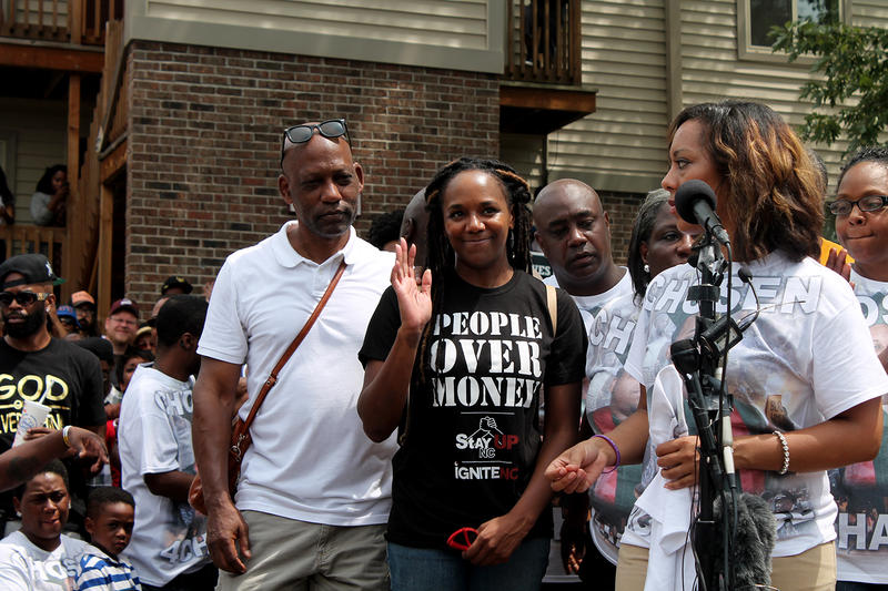 Bree Newsome acknowledges the crowd Sunday in Ferguson.