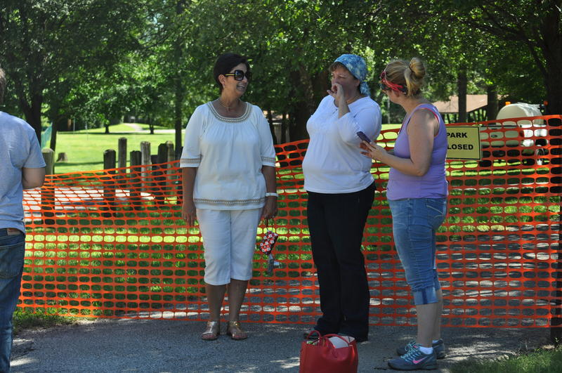 Robbin Dailey of Bridgeton, Mary Osckow of Hazelwood and Meagan Beckermann of Bridgeton survey the newly closed St. Cin Park.