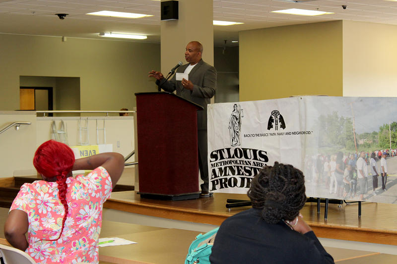James Clark of Better Family Life explains the warrant amnesty voucher process to a group of people wanting to clear their outstanding warrants on Saturday, Aug. 1, 2015.