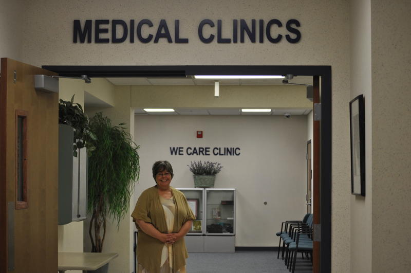 WeCare Clinic director Kim White, a clinical nurse specialist, stands in the waiting room of WeCare's primary care clinic.