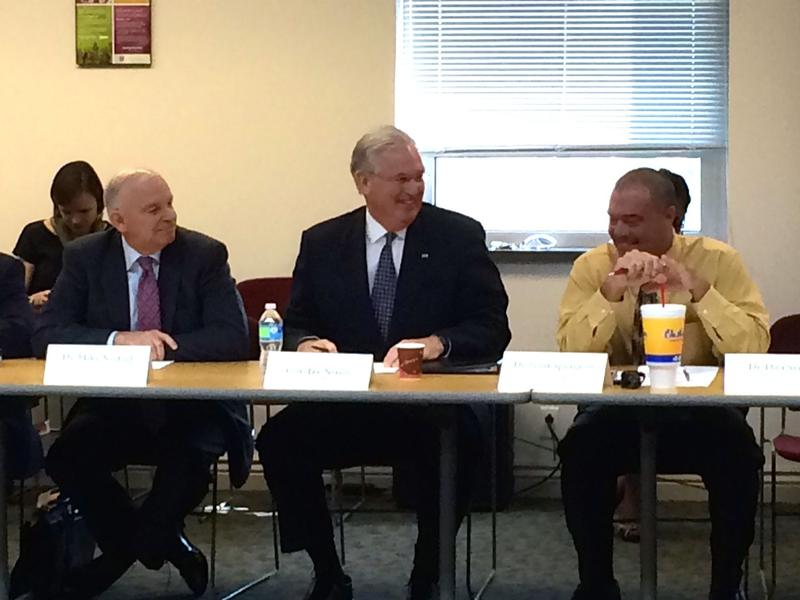 Gov. Jay Nixon, center, listens to an update on efforts to help Riverview Gardens and Normandy at EducationPlus. He is flanked by Riverview Gardens Superintendent Scott Spurgeon, right, and Nixon education adviser Mike Nietzel, left.