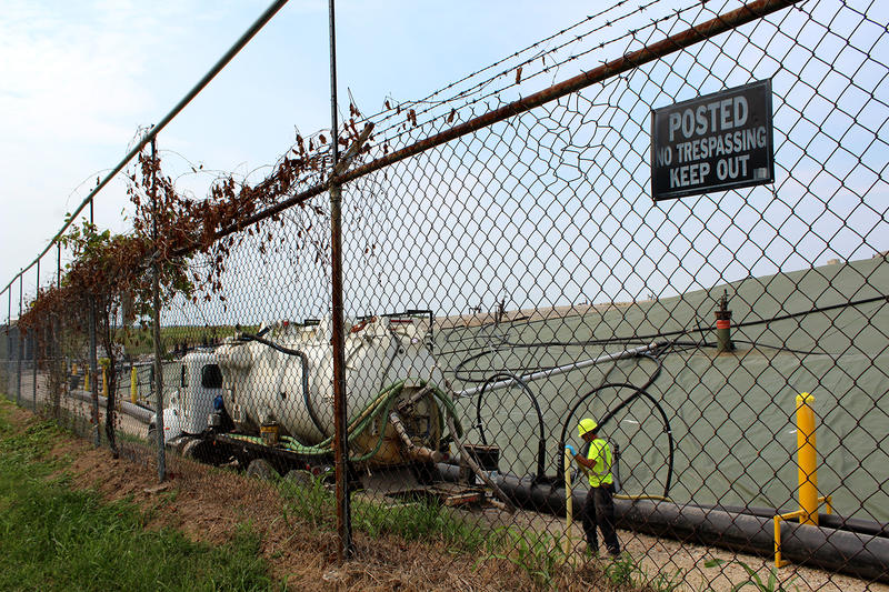A worker does maintenance on a wastewater pump at the Bridgeton Landfill on Aug. 28.
