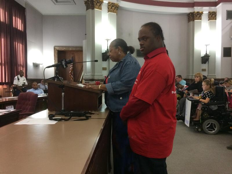 Antonia Banks and her son John Paul testify on Thursday at the Board of Aldermen's Ways and Means Committee. They were speaking in support of a bill exempting sheltered workshops from a mnimum wage hike.