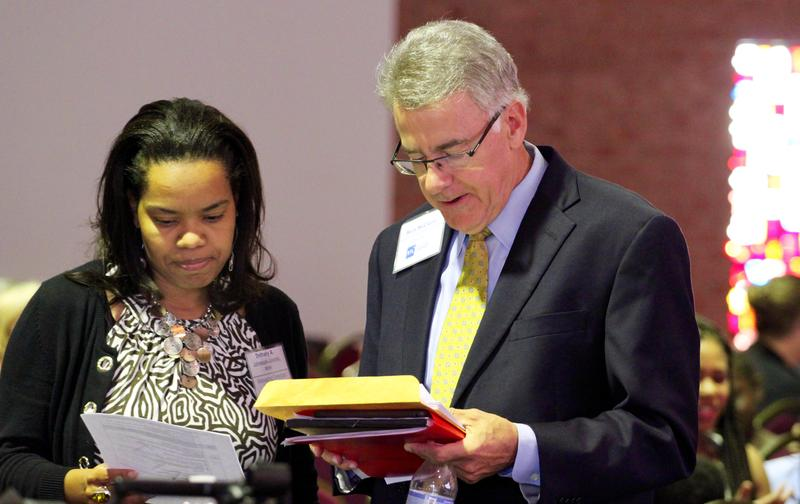 Ferguson Commission manager director Bethany Johnson-Javois and co-chairman Rich McClure look at some notes before the start of Wednesday's meeting.