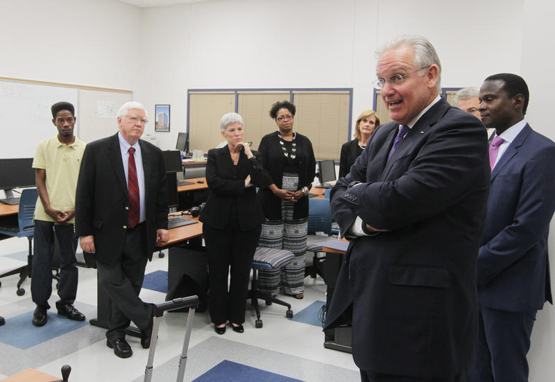 Missouri Governor Jay Nixon, right foreground, meets privately with the Ferguson Commission before accepting its recommendations at a press conference in Florissant on Sept. 14, 2015.