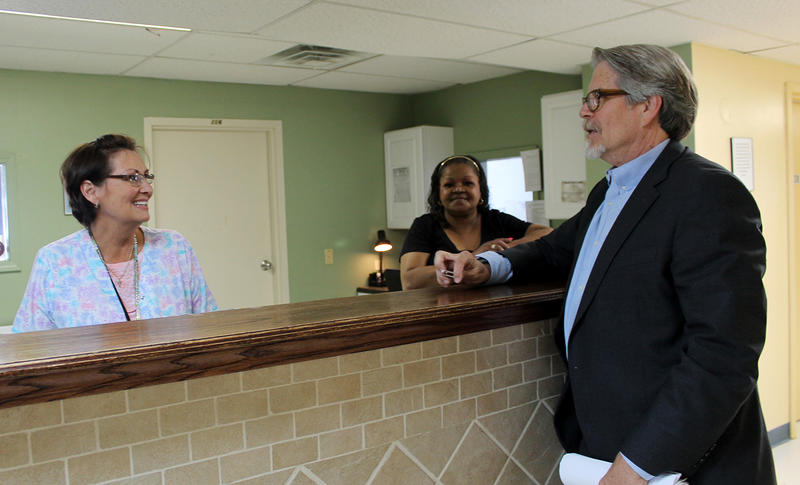 Bridgeway Behavioral Health Director Mike Morrison stands talks with two staff members at Bridgeway's detox center in St. Louis. More than 100 people are waiting to get into their 16 detox beds at any given time.