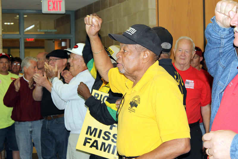 Lew Moye, president emeritus of the Coalition for Black Trade Unionists, raises his fist Saturday, Sept 12, 2015 at a union rally in Arnold, Mo.