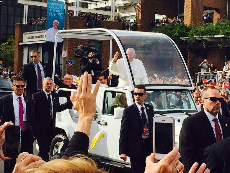 Pope Francis waves to crowds gathered in Philadelphia, which include a group of De Smet Jesuit High School students and faculty.