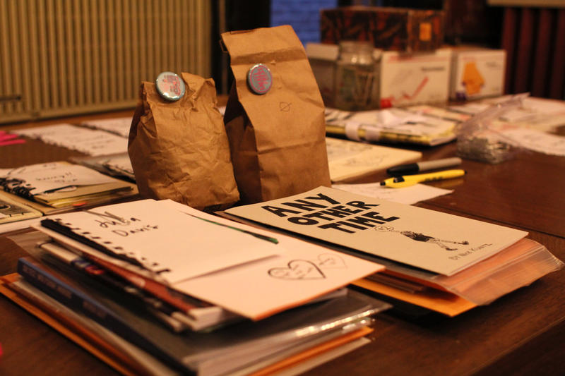 Zines like those stacked on Nickey Rainey's table will be available at the Small Press expo