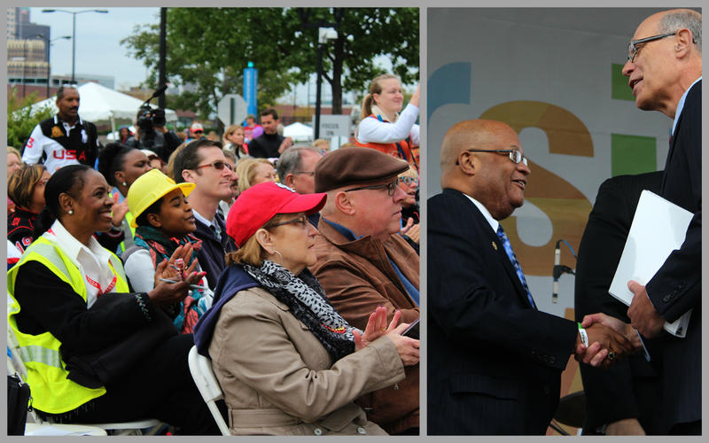 Left: Audience members at an Ameren employee diversity festival clap when Ameren's $2.5 million donation is announced on Sat. Oct. 3, 2015 in St. Louis. Right: Rev. Earl Nance Jr. of Heat Up St. Louis shakes hands with Ameren CEO Warner Baxter.