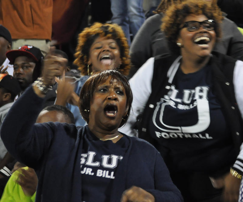 Parents cheer during a football game against Christian Brothers College High School at St. Louis University High on Friday. At left, Verlion Evans cheers for her nephew, Andrew Clair.